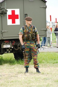 A soldier of the Regiment Carabiniers Prins Boudewijn - Grenadiers posing. This soldier wears a modular vest and his personal weapon (a pistol FN GP).
