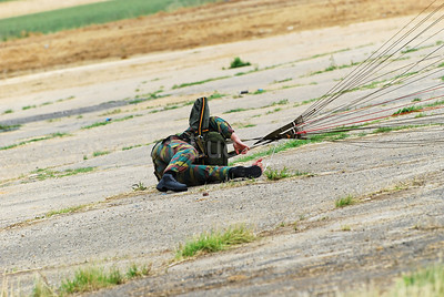 A paratrooper of the Belgian Army landing on firm ground.