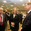 Retiring U.S. Rep. Niki Tsongas is honored by the regional defense community, at a reception at MITRE in Bedford. From left, Air Force Association chairman Whit Peters of Washington, D.C., Niki Tsongas and MITRE COO Pete Sherlock of Sudbury. (SUN/Julia Malakie)