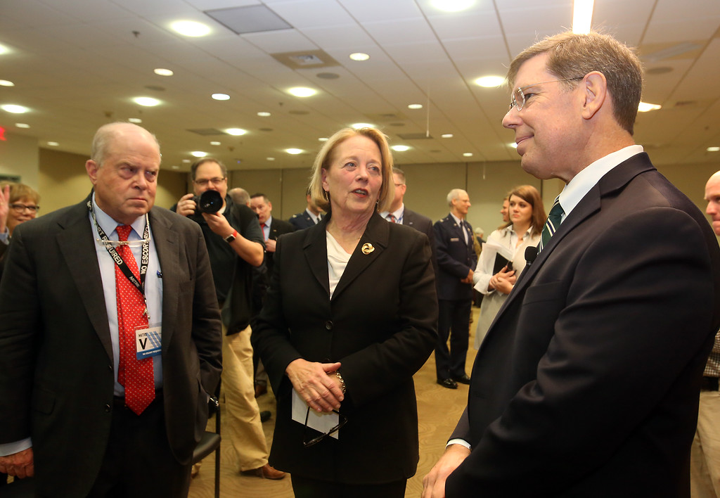 . Retiring U.S. Rep. Niki Tsongas is honored by the regional defense community, at a reception at MITRE in Bedford. From left, Air Force Association chairman Whit Peters of Washington, D.C., Niki Tsongas and MITRE COO Pete Sherlock of Sudbury. (SUN/Julia Malakie)