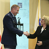 Retiring U.S. Rep. Niki Tsongas is honored by the regional defense community, at a reception at MITRE in Bedford. Col. Chad Ellsworth, installation commander at Hanscom AFB, presents Tsongas with a replica Paul Revere Old North Church lantern. (SUN/Julia Malakie)