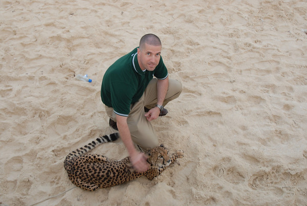 Beach House Bash.  Me playing with the general's pet cheetah.