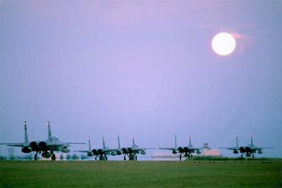 F-15C Eagle aircraft of the 58th Tactical Fighter Squadron takeoff on deployment to Saudi Arabia during Operation Desert Shield.