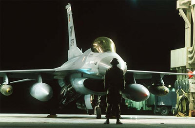 An Falcon is armed with Mark 84 2,000-pound bombs mounted under its wings.