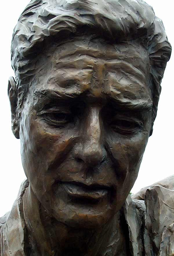 The face of a life-size bronze soldier captures the grief associated with the loss of comrades in arms on the battlefield.
