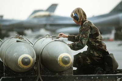 A Staff Sgt. checks over Mark 84 2,000-pound bombs as the ordnance is readied for loading aboard 401st Tactical Fighter Wing F-16 Fighting Falcon aircraft. The aircraft will be conducting the first daylight strike against Iraqi targets during Operation Desert Storm.