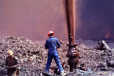 Contractors extinguish an oil fire in Kuwait during Operation Desert Storm.
