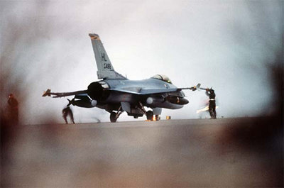 An F-16C Fighting Falcon fighter aircraft from the 388th Tactical Fighter Wing, Hill Air Force Base, Utah, is prepared for a strike against targets in Iraq and Kuwait during Operation Desert Storm.