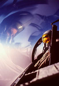 Lt. Col. George Wagasky of the 1st Tactical Fighter Wing scans the horizon from the cockpit of his F-15D Eagle aircraft while on a combat patrol near the Iraqi border during Operation Desert Shield.