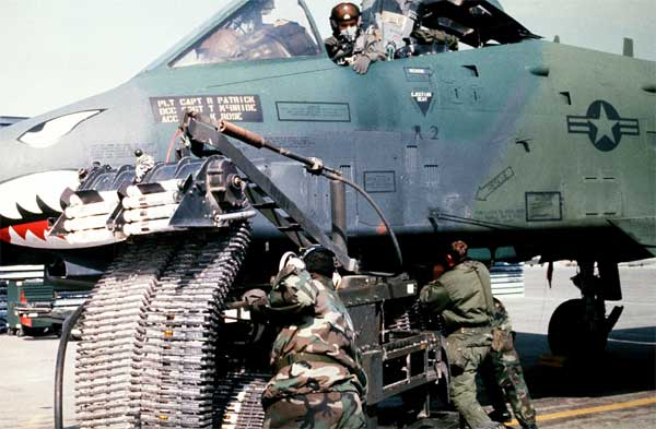 Munitions specialists from the 23rd Tactical Fighter Wing, England Air Force Base, La., load 30mm rounds of ammunition into an A-10A Thunderbolt II attack aircraft for its GAU-8/A Avenger cannon prior to a sortie in support of Operation Desert Storm.