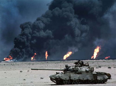 This Iraqi tank was photographed in front of burning oil wells during Desert Storm in 1991.