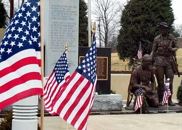 Flags adorn the walkway leading to the 14th Quartermaster Detachment Memorial at the Army Reserve center in Greensburg, Pa.