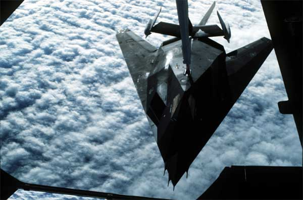 A 37th Tactical Fighter Wing F-117A stealth fighter aircraft refuels from a 22nd Air Refueling Wing KC-10 Extender aircraft during Operation Desert Shield.