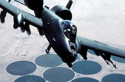 An A-10A Thunderbolt II aircraft flies over a target area during Operation Desert Storm.