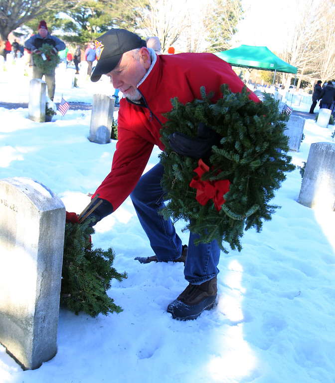 . Brian Cusick of Leominster participates in Wreaths Across America ceremony at Fort Devens Cemetery, where volunteers laid wreaths on 432 veterans\' graves. (SUN/Julia Malakie)