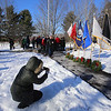 Wreaths Across America ceremony at Fort Devens Cemetery, where volunteers laid wreaths on 432 veterans' graves. US Army SGT Sonya Morand of Framingham takes a picture of the wreaths for each service branch, after the ceremony. (SUN/Julia Malakie)
