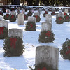 Some of the wreaths laid at Wreaths Across America ceremony at Fort Devens Cemetery, where volunteers laid wreaths on 432 veterans' graves. (SUN/Julia Malakie)