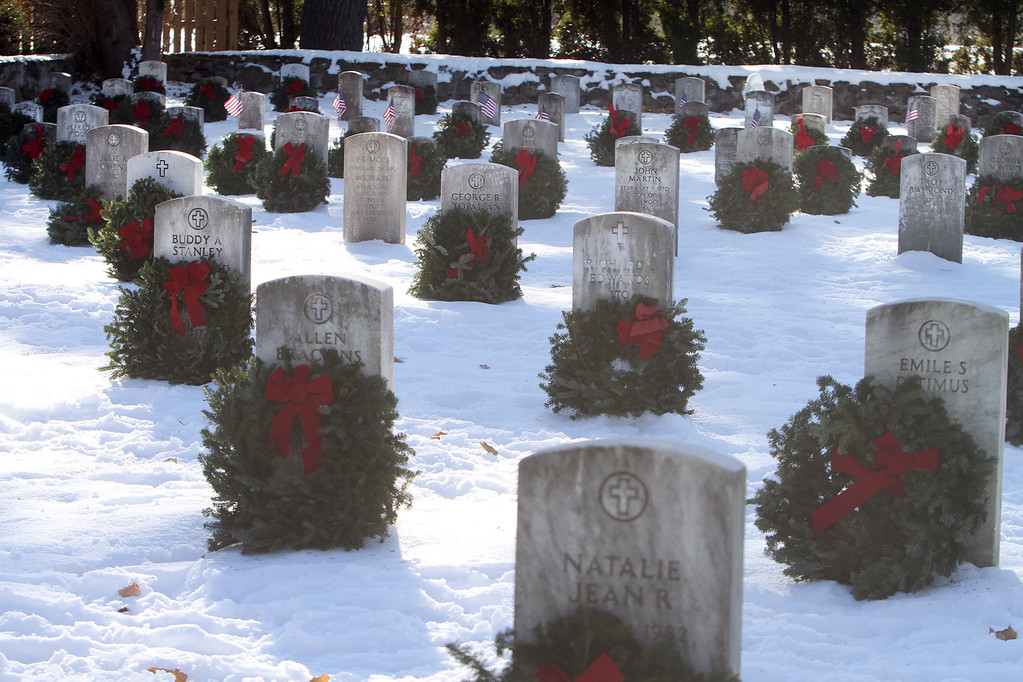 . Some of the wreaths laid at Wreaths Across America ceremony at Fort Devens Cemetery, where volunteers laid wreaths on 432 veterans\' graves. (SUN/Julia Malakie)