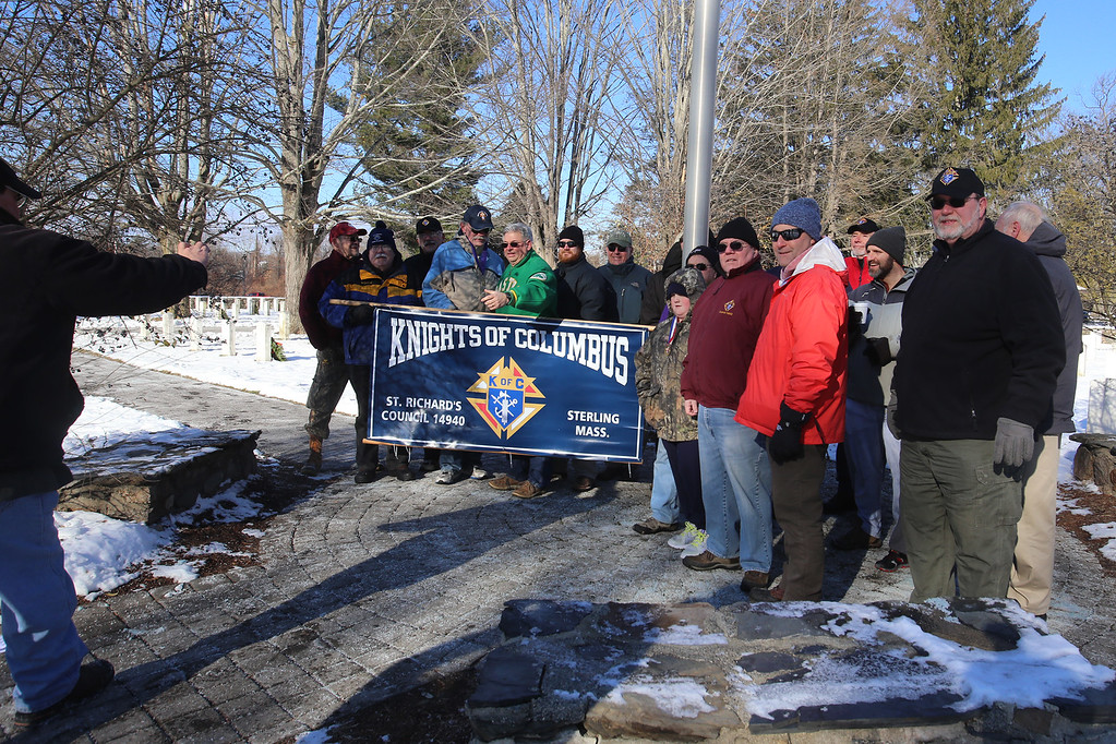 . Knights of Columbus members gather for a group photo after participating in Wreaths Across America ceremony at Fort Devens Cemetery, where volunteers laid wreaths on 432 veterans\' graves. (SUN/Julia Malakie)
