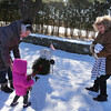 Wreaths Across America ceremony at Fort Devens Cemetery, where volunteers laid wreaths on 432 veterans' graves. Andrea Cunningham of Worcester and her daughter Nora Cunningham, 1-1/2, and mother Imelda Fisher of Leominster, lay a wreath at the grave of Fisher's husband Mark Fisher, who was a Green Beret in Desert Storm, retired, who died in 2008.(SUN/Julia Malakie)