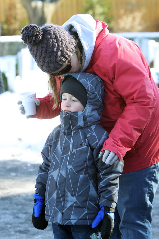 . Jessica Filz of Shirley with son Hunter Filz, 5, at Wreaths Across America ceremony at Fort Devens Cemetery, where volunteers laid wreaths on 432 veterans\' graves. (SUN/Julia Malakie)