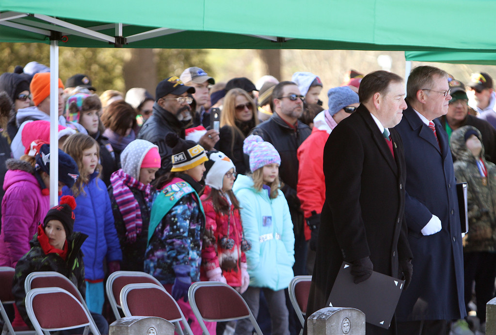 . Wreaths Across America ceremony at Fort Devens Cemetery, where volunteers laid wreaths on 432 veterans\' graves. (SUN/Julia Malakie)