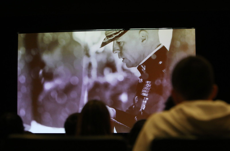 Dracut High juniors watch a Massachusetts Fallen Heroes video during a presentation about Memorial Day and what they can do to remember fallen heroes in their community. (SUN/Julia Malakie)