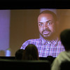 Massachusetts Fallen Heroes volunteer Marine Cpl (Ret.) Dwayne Smith of Methuen, appears in a video, before speaking to Dracut High juniors about Memorial Day and what they can do to remember fallen heroes in their community. (SUN/Julia Malakie)