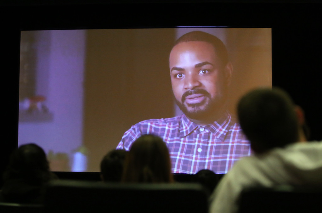. Massachusetts Fallen Heroes volunteer Marine Cpl (Ret.) Dwayne Smith of Methuen, appears in a video, before speaking to Dracut High juniors about Memorial Day and what they can do to remember fallen heroes in their community. (SUN/Julia Malakie)