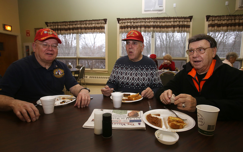 Dracut Council on Aging holds monthly Veterans Breakfast at the Dracut Senior Center, for veterans, their families, and those interested in veterans' affairs. From left, retired Marines Leonard Gaudette of Lawrence and Peter Manning of Dracut, and retired Dracut Veterans' Agent Billy Zounes of Dracut. (SUN/Julia Malakie)
