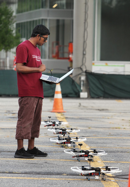 Demonstrations with drones at Air Force UAS Pitch Day, at Northeastern University's Innovation Campus. NU PhD students including Abdullah Al Bashit of Bangladesh and Boston, set up drones for a demonstration of NU's project about using a swarm to detect and track a target. (SUN/Julia Malakie)