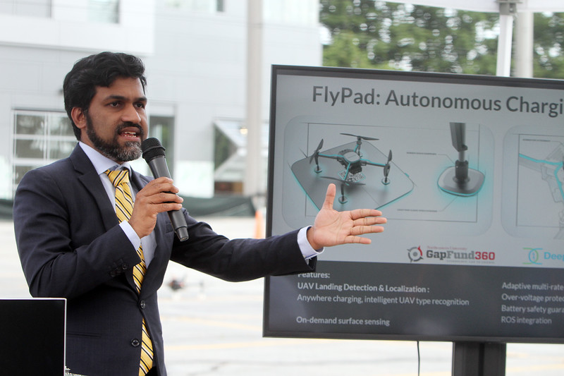 Demonstrations with drones at Air Force UAS Pitch Day, at Northeastern University's Innovation Campus. NU associate professor of electrical & computer engineering Kaushik Chowdhury leads a demonstration of autonomous drone recharging, with the drone landing on a recharging station on the roof of a military vehicle. (SUN/Julia Malakie)