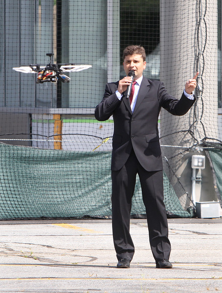 Demonstrations with drones at Air Force UAS Pitch Day, at Northeastern University's Innovation Campus. NU assistant professor of electrical & computer engineering Jose Martinez Lorenzo of Wellesley demonstrates NU's project about using a swarm of drones to detect and track a target. He was demonstration collision avoidance, where if he approached the drone, it would rise out of collision range. (SUN/Julia Malakie)