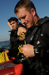 091012-N-0260R-164 - ALEXANDRIA, Egypt - Explosive Ordinance Disposal Petty Officer 2nd Class Roy Wiggins and Lt. Cole Sailors and Evans, both from Explosive Ordinance Disposal Mobile Unit 3, prepare to enter the water to supervise Egyptian and Pakistani Navy students placing underwater demolition charges during a recent training exercise.  The training was conducted as part of Bright Star 2009. Bright Star is a multinational exercise designed to improve readiness, interoperability, strengthen the military and professional relationships among U.S., Egyptian and participating forces. Bright Star is conducted by U.S. Central Command and held every two years. (U.S. Navy photo by Mass Communication Specialist 1st Brandon Raile/Released)