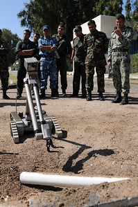 091015-N-0260R-061- ALEXANDRIA, Egypt - Sailors and Soldiers from the Pakistani and Egyptian Armed Forces watch as Sailors from Explosive Ordinance Disposal Mobile Unit 3 provide a class on using the PackBot robot system to investigate a simulated Improvised Explosive Device (IED).  The training was conducted as part of Bright Star 2009. Bright Star is a multinational exercise designed to improve readiness, interoperability, strengthen the military and professional relationships among U.S., Egyptian and participating forces. Bright Star is conducted by U.S. Central Command and held every two years. (U.S. Navy photo by Mass Communication Specialist 1st Brandon Raile/Released)