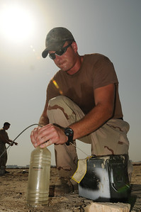 091017-N-0260R-043 - ALEXANDRIA, Egypt - Explosive Ordinance Disposal Petty Officer 2nd Class Roy Wiggins prepares an explosive charge during training conducted for Sailors and Soldiers from the Egyptian Armed Forces and Pakistani Navy.  The training was conducted as part of Bright Star 2009. Bright Star is a multinational exercise designed to improve readiness, interoperability, strengthen the military and professional relationships among U.S., Egyptian and participating forces. Bright Star is conducted by U.S. Central Command and held every two years. (U.S. Navy photo by Mass Communication Specialist 1st Class Brandon Raile/RELEASED)