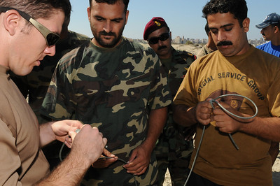 091012-N-0260R-076 - ALEXANDRIA, Egypt - Sailors from the Pakistani Navy listen as Explosive Ordinance Disposal Petty Officer 1st Class Mark Peters of Explosive Ordinance Disposal Mobile Unit 3 demonstrates construction of underwater demolition charges.  The training was conducted as part of Bright Star 2009. Bright Star is a multinational exercise designed to improve readiness, interoperability, strengthen the military and professional relationships among U.S., Egyptian and participating forces. Bright Star is conducted by U.S. Central Command and held every two years. (U.S. Navy photo by Mass Communication Specialist 1st Brandon Raile/Released)