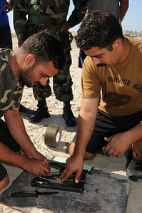 091012-N-0260R-113 - ALEXANDRIA, Egypt - Sailors from the Pakistani Navy practice construction of underwater demolitions charges following training from Sailors from Explosive Ordinance Disposal Mobile Unit 3.  The training was conducted as part of Bright Star 2009. Bright Star is a multinational exercise designed to improve readiness, interoperability, strengthen the military and professional relationships among U.S., Egyptian and participating forces. Bright Star is conducted by U.S. Central Command and held every two years. (U.S. Navy photo by Mass Communication Specialist 1st Brandon Raile/Released)