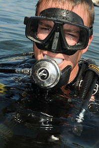 091014-N-0260R-106 - ALEXANDRIA, Egypt - Explosive Ordinance Disposal Petty Officer 2nd Class Roy Wiggins watches as Sailors from the Pakistani and Egyptian Navies assemble on the surface prior to diving to search the hull of a ship for attached explosive devices.  The dive was part of training provided by Sailors from Explosive Ordinance Disposal Mobile Unit 3 during exercise Bright Star 2009. Bright Star is a multinational exercise designed to improve readiness, interoperability, strengthen the military and professional relationships among U.S., Egyptian and participating forces. Bright Star is conducted by U.S. Central Command and held every two years. (U.S. Navy photo by Mass Communication Specialist 1st Brandon Raile/Released)