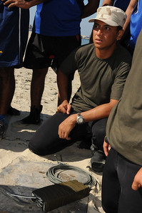 091012-N-0260R-111 - ALEXANDRIA, Egypt - Sailors and Soldiers from the Egyptian Armed Forces and Pakistani Navy listen as Sailors from Explosive Ordinance Disposal Mobile Unit 3 discusses construction of underwater demolitions charges.  The training was conducted as part of Bright Star 2009. Bright Star is a multinational exercise designed to improve readiness, interoperability, strengthen the military and professional relationships among U.S., Egyptian and participating forces. Bright Star is conducted by U.S. Central Command and held every two years. (U.S. Navy photo by Mass Communication Specialist 1st Brandon Raile/Released)