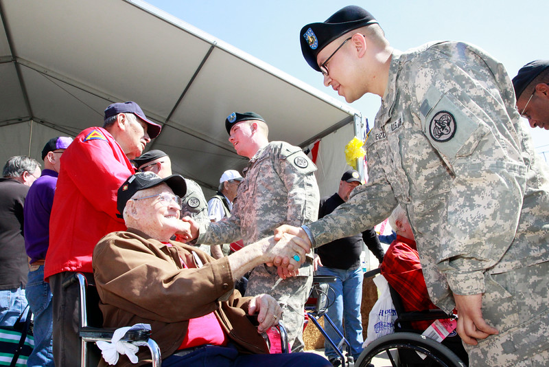 WWII veterans welcome in our active duty military and their families at the Houston Livestock Show and Rodeo.