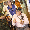 WWII Veterans participate in the Houston Livestock Show and Rodeo Armed Forces Appreciation Day. KC Cox from the Armed Forces Committee escorts WWII veteran Roy Hughes