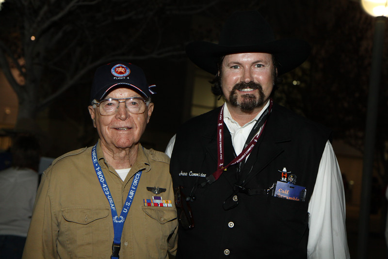 WWII Veterans participate in the Houston Livestock Show and Rodeo Armed Forces Appreciation Day. WWII veteran James Brown visits with a Livestock show volunteer.
