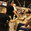WWII Veterans participate in the Houston Livestock Show and Rodeo Armed Forces Appreciation Day. WWII veterans greet wounded warriors of the Marine Outdoors organization.