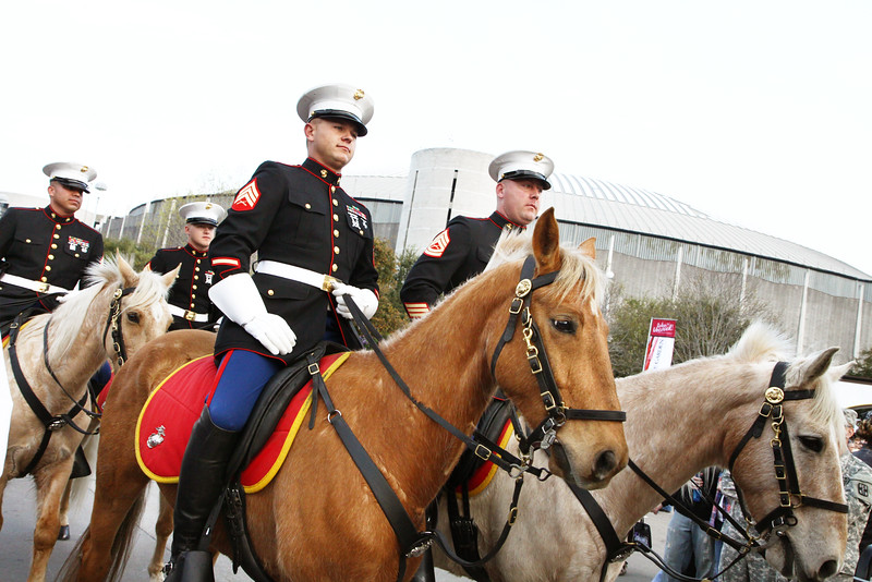 WWII Veterans participate in the Houston Livestock Show and Rodeo Armed Forces Appreciation Day. Marine Guard.