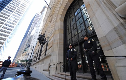 Officers guard the entrance to the Federal Reserve Bank, Friday, April 24, 2009, in New York.  Federal regulators will privately begin telling the nation's 19 largest financial institutions how well they performed in stress tests to assess their soundness. (AP Photo/ Louis Lanzano)