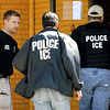 Immigration and Customs Enforcement agents enter a restaurant to remove evidence in Cheektowaga, N.Y., Wednesday April 16, 2008. A Buffalo-area restaurant owner and nine business associates are accused of smuggling illegal Mexican immigrants into the U.S. to work in restaurants in New York, Pennsylvania, Ohio and West Virginia. (AP Photo/David Duprey)