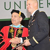 Dylan Hicks, of Pittsfield, receives his undergraduate degree during the commencement ceremony at Fitchburg State University on Saturday morning. Earlier in the morning, along with Dylan Finn, of Dedham, and Seth Lavenski, of Ashburnham, attended the Commissioning Ceremony at WPI and became 2nd Lieutenants in the United States Army. SENTINEL & ENTERPRISE / Ashley Green