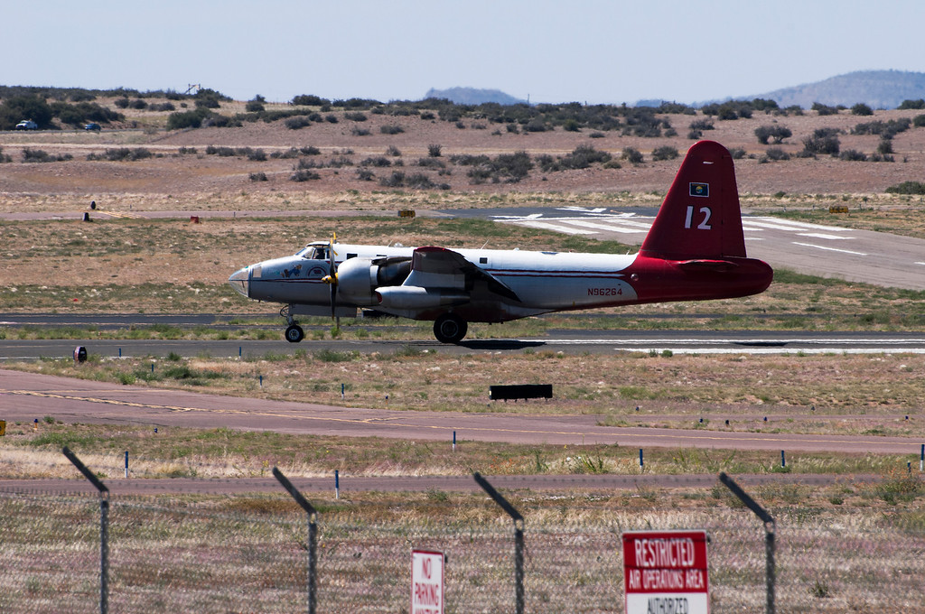 P-2V Neptune<br /> Airport, Prescott, Arizona<br /> The was a naval patrol bomber and anti-submarine warfare<br /> aircraft for the United States Navy. The P-2 Neptune replaced the PV-1 Ventura and PV-2 Harpoon and is being replaced, in turn, with the P-3 Orion. The P2V aircraft were rebuilt and converted into aerial tankers with a maximum fire retardant capacity of 2,700 gallons with six door retardant dispensing tanks. Over 8 P2Vs are currently employed in aerial firefighting roles by operators such as Aero Union and Neptune Aviation Services.