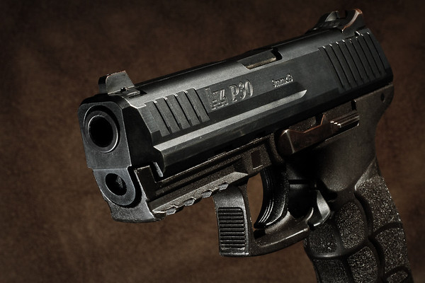 Gun magazines (especially tactical ones) love to use very...striking shots for their articles. I think I forgot the bright red light somewhere...  What do you think of these kinds of shots?  This is the HK P30 I daily carry. Reliable, fantastic piece of German engineering.